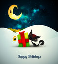 Kitten playing with gift box alone in the snow und under moonlight layered eps vector background Stock Image
