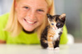 Kitten teen girl cute little and closeup Stock Photos