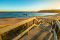Kitty miller bay lookout wooden boardwalks to the beach of at sunset in phillip island victoria australia Royalty Free Stock Photo