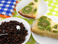 Kiwi cake on white plate with coffee beans set Royalty Free Stock Images