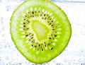 Kiwi covered with bubbles sliced Stock Photography