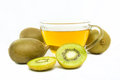Kiwi flavored tea in cup and piece of fruit isolated on white background Stock Image