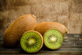 Kiwi fruit fresh on wooden background Stock Photo