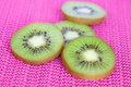 Kiwi fruit on pink background Stock Photography