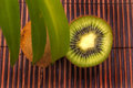 Kiwi fruit ripe on a bamboo mat Royalty Free Stock Images