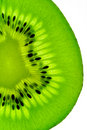 Kiwi fruit  slice on a light table Royalty Free Stock Photography
