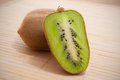 Kiwi fruit sliced on a bamboo mat studio shot Stock Photo