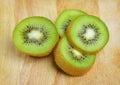 Kiwi fruit sliced segments on wooden background Royalty Free Stock Image