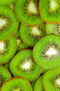 Kiwi fruit slices background green Stock Image