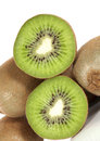Kiwi fruit whole and halved on white background Royalty Free Stock Photography