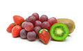 Kiwi, grapes and strawberries on a white background Royalty Free Stock Photo
