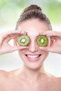 Kiwi healthy fruit funny woman holding fruit for her eyes Stock Photography
