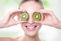 Kiwi healthy fruit funny woman holding fruit for her eyes Stock Image
