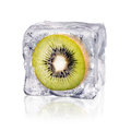 Kiwi in an ice cube a enclosed before white background Royalty Free Stock Photography