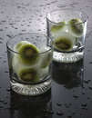 Kiwi ice cubes frozen slices in glasses with water drops Stock Images