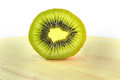 Kiwi portion a on wood chopping block Stock Photos