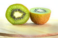 Kiwi portion a on wood chopping block Stock Photography