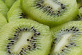 Kiwi slices close up organic fruits background Stock Images