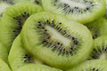 Kiwi slices close up organic fruits background Stock Photo