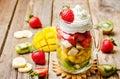 Kiwi strawberry banana mango salad with whipped cream Royalty Free Stock Photo