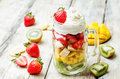 Kiwi strawberry banana mango salad with whipped cream Royalty Free Stock Photo