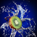 Kiwi in water splash Stock Photos
