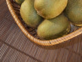 Kiwis in a rattan baske Stock Photos