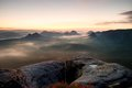 Kleiner Winterberg view. Fantastic dreamy sunrise on the top of the rocky mountain with the view into misty valley Royalty Free Stock Photo