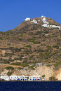 Klima fishing village scenic view of with homes on mountain in background milos island greece Royalty Free Stock Photography