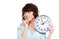 Klocka som rymmer den fundersama kvinnan ung Fotografering för Bildbyråer
