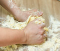 Kneading dough on the kitchen table closeup of woman hands Royalty Free Stock Photo