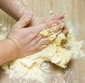 Kneading dough on the kitchen table closeup of woman hands Royalty Free Stock Photography