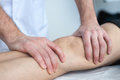 Knee injure doctor examines a problematic Royalty Free Stock Photography