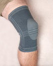 Knee injury leg with brace on due to Royalty Free Stock Photo