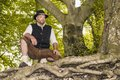 Kneeling man in traditional Bavarian costumes Stock Image