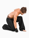 Kneeling martial arts fighter Royalty Free Stock Photo