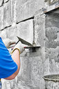 Knife applying paint and plaster on awall. Stock Photos