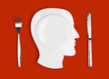 Knife brain plate and fork on red background head Royalty Free Stock Photos