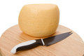Knife and cheese on a cutting board Royalty Free Stock Photos