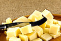 Knife and cheese diced hard a Stock Image