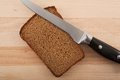 Knife and chopped rye bread Stock Photos