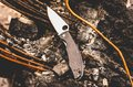 Knife for city carrying. Knife with a hole in the blade. Horizontal frame.. Urban style.