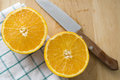 Knife cut of fresh orange Stock Image