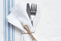 Knife and fork with blue and white linen Royalty Free Stock Image