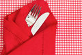 Knife and fork with check tablecloth Stock Image
