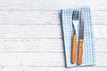 Knife and fork on checkered napkin the Stock Images