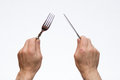 Knife and fork in hands Royalty Free Stock Photo