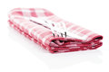 Knife fork red checkered towel white background Stock Photography