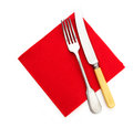 Knife and fork on red paper serviette napkin over white hungry ready for dinner Royalty Free Stock Photo