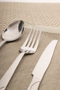 Knife fork and spoon with linen serviette see my other works in portfolio Stock Photography